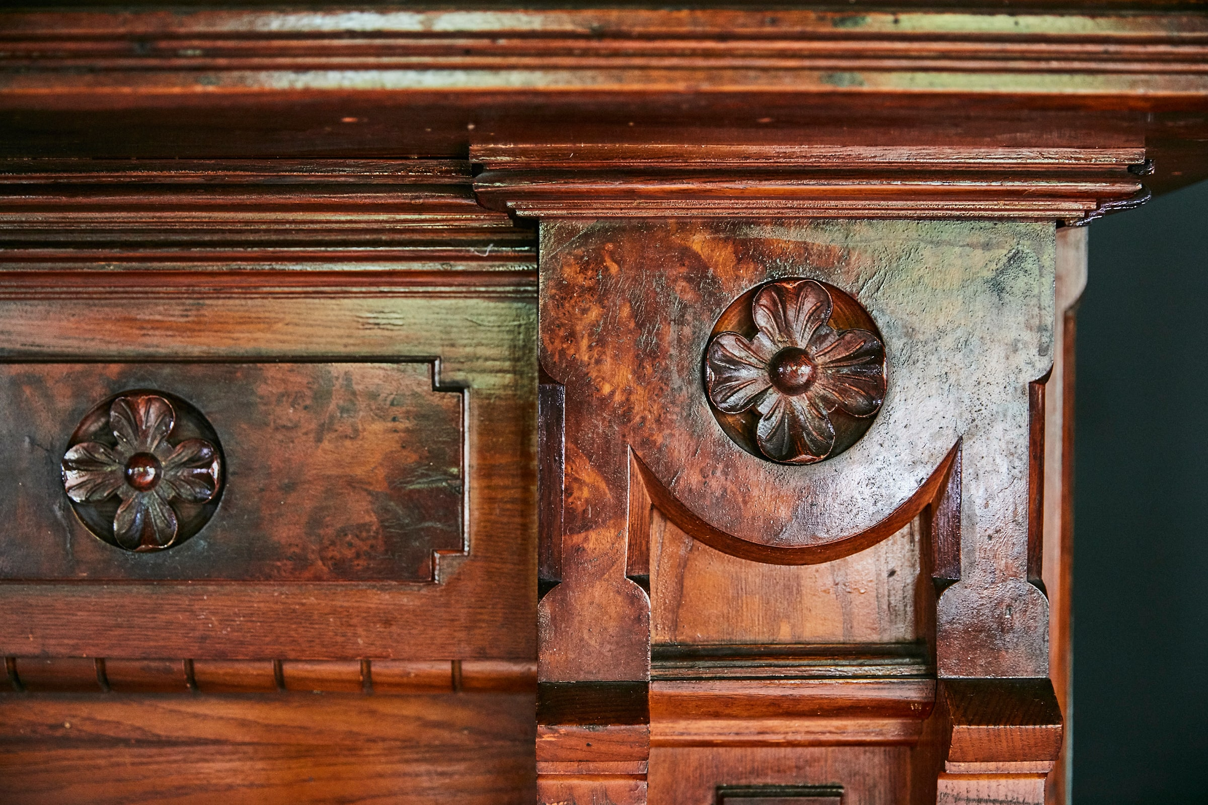 detail of wooden mantlepiece